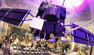 A model of orbiter Rosetta hangs from the ceiling in a conference room at the European Space Agency ESA in Darmstadt, Germany, Friday, Sept. 30, 2016. Rosetta will be impacted on comet 67P/Churyumov-Gerasimenko on Friday, marking the end of the twelve years lasting Rosetta mission. (AP Photo/Michael Probst)