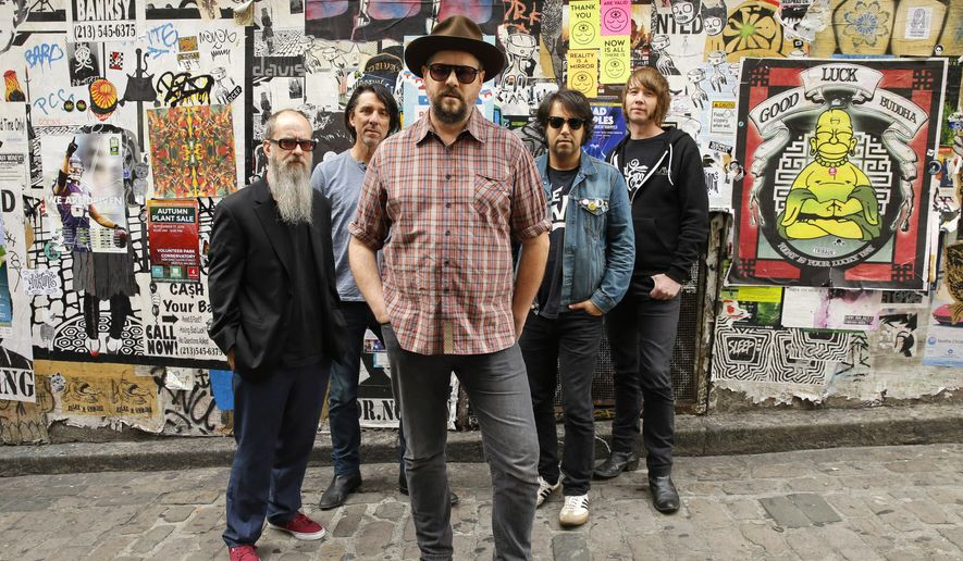 """Members of the alternative country band Drive-By Truckers, from left, Brad Morgan, Mike Cooley, Patterson Hood, Jay Gonzalez, and Matt Patton pose for a photo, Thursday, Sept. 29, 2016, before playing a show in Seattle. The band's latest album  """"American Band,"""" was released on Friday.  (AP Photo/Ted S. Warren)"""