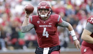 FILE - In this Saturday, Sept. 17, 2016, file photo, Washington State quarterback Luke Falk (4) looks for a receiver as he runs with the ball during the first half of an NCAA college football game against Idaho in Pullman, Wash. Washington State defeated Oregon in double overtime last year, a game that ignited the Cougars run to a 9-4 record and a bowl game victory over Miami. (AP Photo/Young Kwak, File)