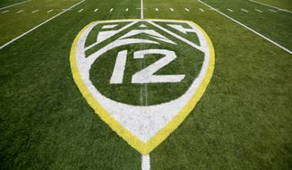ADVANCE FOR SATURDAY, OCT. 1 - In this Oct. 10, 2015, file photo,  a PAC-12 logo is seen painted on the field before an NCAA college football game between Washington State and Oregon in Eugene, Ore. Larry Scott helped transform and modernize the Pac-12 when he took over as commissioner, helped the conference land a $3 billion TV deal and create its own network. Eight years later, the conference is reaping financial rewards and he believes it is well-positioned to adapt to the changing landscape of both college sports and media rights. (AP Photo/Ryan Kang, File)