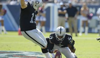 FILE - In this Sept. 25, 2016, file photo, Oakland Raiders kicker Sebastian Janikowski (11) boots a 52-yard field goal against the Tennessee Titans as Marquette King (7) holds in the first half of an NFL football game in Nashville, Tenn. Janikowski set an NFL record last week with his 53rd field goal of at least 50 yards. (AP Photo/Mark Zaleski, File)
