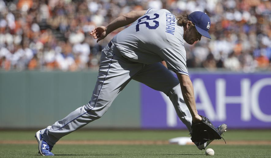 Los Angeles Dodgers pitcher Clayton Kershaw fields a ground out hit by San Francisco Giants' Joe Panik during the third inning of a baseball game in San Francisco, Saturday, Oct. 1, 2016. (AP Photo/Jeff Chiu)