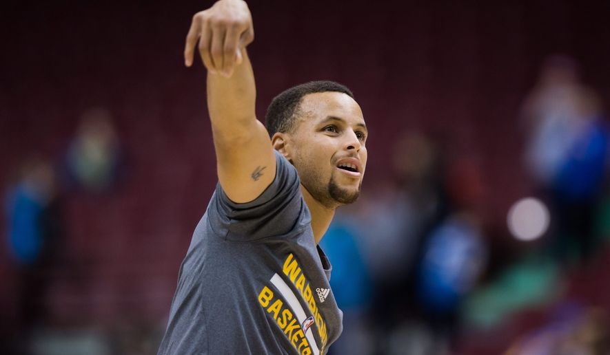 Golden State Warriors' Stephen Curry watches a shot while warming up before a preseason NBA basketball game against the Toronto Raptors in Vancouver, British Columbia, Saturday Oct. 1, 2016. (Darryl Dyck/The Canadian Press via AP)