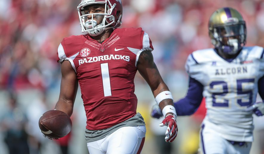 Arkansas wide receiver Jared Cornelius scores a touchdown during the first quarter of an NCAA football game against Alcorn State, Saturday, Oct. 1, 2016, in Little Rock, Ark. (AP Photo/ Chris Brashers)