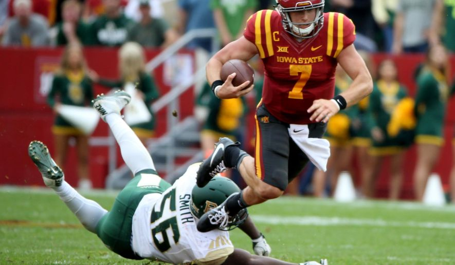Iowa State quarterback Joel Lanning is tripped up by Baylor defensive end K.J. Smith during the first half of an NCAA college football game, Saturday, Oct. 1, 2016, in Ames, Iowa. (AP Photo/Justin Hayworth)