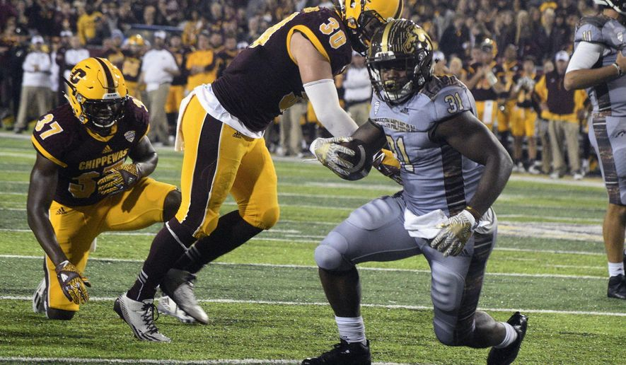 Western Michigan's Jarvion Franklin (31) looks for the goal line during an NCAA college football game against Central Michigan, Saturday, Oct. 1, 2016, in Mount Pleasant, Mich. (Jim Lahde /The Morning Sun via AP)