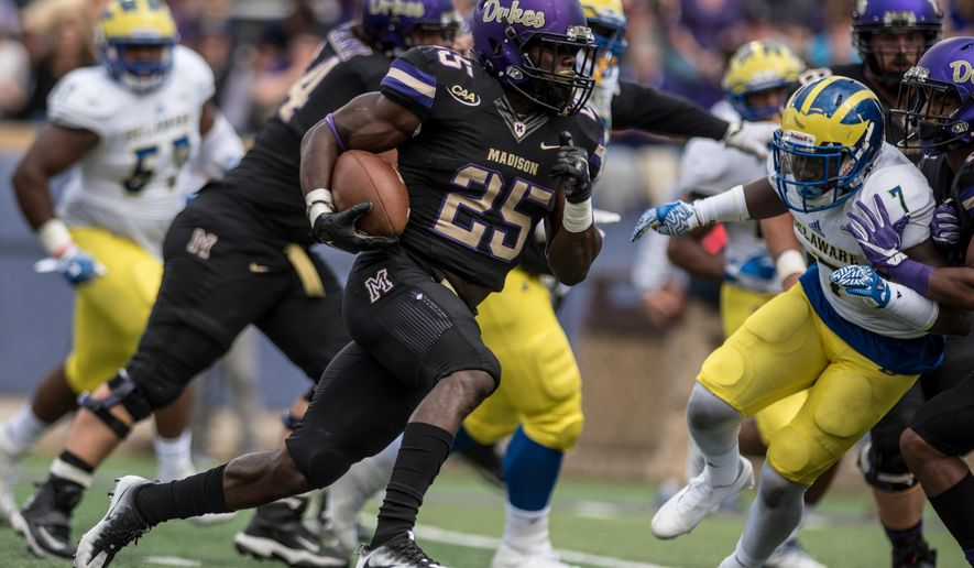 James Madison running back Cardon Johnson (25) moves the ball up the field during the first half of an NCAA football game against Delaware in Harrisonburg, Va., Saturday, Oct. 1, 2016. (Daniel Lin/Daily News-Record via AP)
