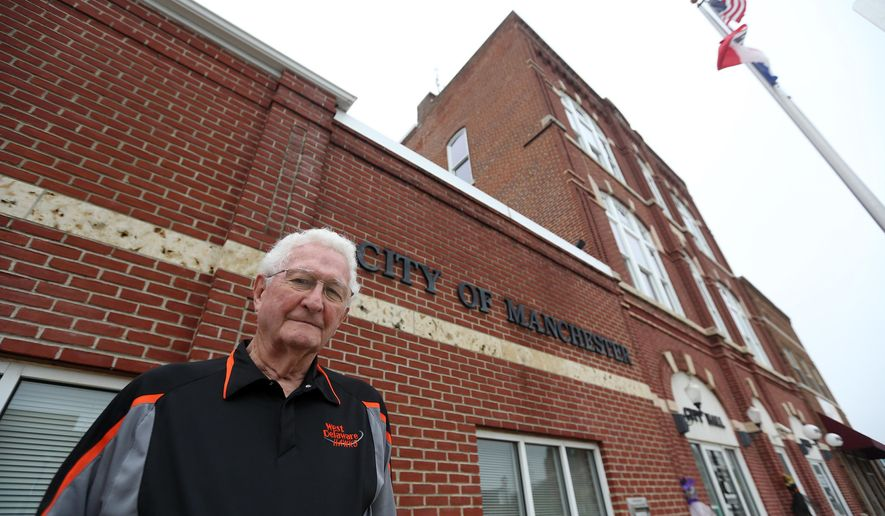 In this photo from Friday, Sept. 23, 2016, Milt Kramer stands near city hall in Manchester, Iowa. Kramer has served as mayor since 1974. (Jessica Reilly/Telegraph Herald via AP)