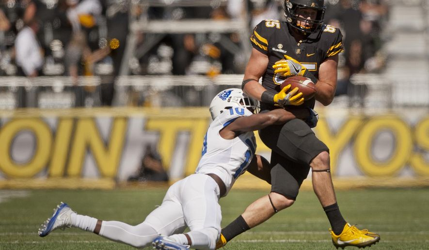 Appalachian State wide receiver Barrett Burns bobbles then catches a pass under pressure from Georgia State cornerback Chandon Sullivan in the second quarter of an NCAA college football game, Saturday Oct. 1, 2016 at Kidd Brewer Stadium in Boone, N.C. (Walt Unks/The Winston-Salem Journal via AP)