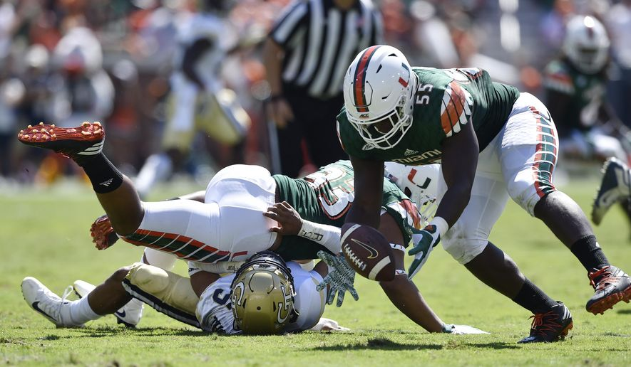 Miami linebacker Shaquille Quarterman (55) picks up a fumble and returns it for a touchdown against Georgia Tech during the first half of an NCAA college football game, Saturday, Oct. 1, 2016, in Atlanta. (AP Photo/Mike Stewart)