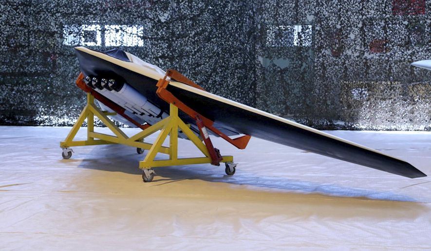 """This photo released on Saturday, Oct. 1, 2016, by the Iranian Revolutionary Guard, shows a new attack drone called Saegheh or Thunderbolt in an undisclosed location in Iran. Iranian media says the Revolutionary Guard has built a new attack drone which is similar to a U.S. drone captured five years ago. The semi-official Tasnim news agency says the """"Saegheh"""" drone was built by the Guard's aerospace division and is similar to the RQ-170 Sentinel spy drone. (Sepahnews of the Iranian Revolutionary Guards via AP)"""