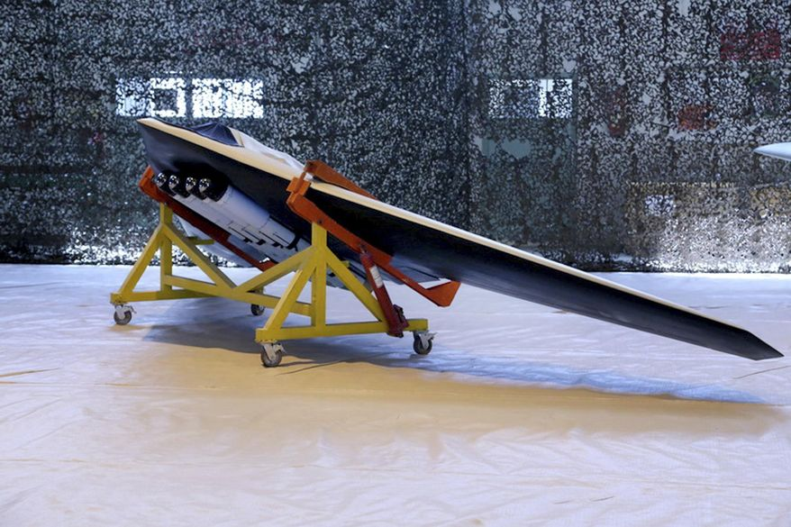"""This photo released on Saturday, Oct. 1, 2016, by the Iranian Revolutionary Guard, shows a new attack drone called Saegheh or Thunderbolt in an undisclosed location in Iran. Iranian media says the Revolutionary Guard has built a new attack drone which is similar to a U.S. drone captured five years ago. The semi-official Tasnim news agency says the """"Saegheh"""" drone was built by the Guard's aerospace division and is similar to the RQ-170 Sentinel spy drone. (Sepahnews of the Iranian Revolutionary Guards via AP) **FILE**"""