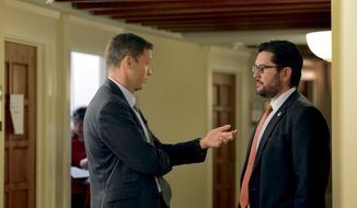 Brian F. Egolf Minority Floor Leader, D-Santa Fe and Nate Gentry Majority Floor Leader, R- Bernalillo (from right) have a private discussion in the basement hallway outside the door of the New Mexico House of Representatives during the second day of the New Mexico Special Legislative Session Saturday, Oct. 1, 2016 in Santa Fe, New Mexico. /Santa Fe New Mexican via AP)