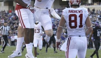 Oklahoma wide receiver Dede Westbrook (11) celebrates catching a touchdown pass with quarterback Baker Mayfield (6) as wide receiver Mark Andrews (81) looks on  during the first half of an NCAA college football game against TCU, Saturday, Oct. 1, 2016, in Fort Worth, Texas. (AP Photo/LM Otero)