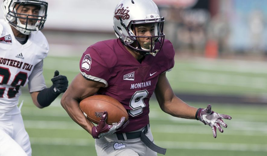 Montana wide receiver Justin Calhoun (9) runs for a touchdown after a reception against Southern Utah in an NCAA college football game Saturday, Oct. 1, 2016, in Missoula, Mont. (AP Photo/Patrick Record)