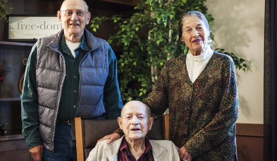 In this Thursday, Sept. 22, 2016 photo, from left, delegates to the 1972 Montana Constitutional Convention and Great Falls residents Bob Woodmansey, Don Rebal and Arlyne Reichert pose for a photo in Great Falls, Mont. What they produced was a ground-breaking document that was barely passed by voters amid heated debate, according to the Great Falls Tribune. (Julia Moss/The Great Falls Tribune via AP)