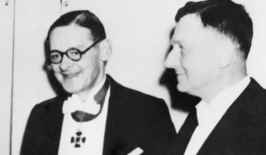 FILE -  In this file photo dated December 10, 1948, Nobel Prize winners of 1948, shortly after being presented their prize inside the concert hall in Stockholm, Sweden.  English writer T.S. Eliot Nobel Prize for Literature and the Swiss Scientist Paul Mueller Nobel Prize for Medicine.  Mueller was honored for discovering that the powerful pesticide DDT killed flies and mosquitoes to fight Typhus and Malaria, but ended up doing both good and bad as it also poisoned wildlife.  Nobel Prizes cannot be changed or revoked, so the judges must put a lot of thought into their selections, with this year's awards due to be announced over the next two weeks. (AP Photo/FILE)