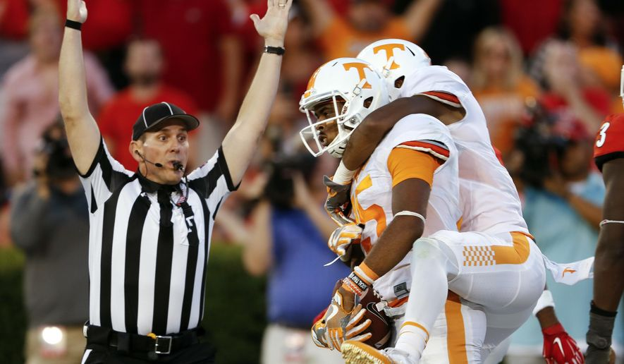 Tennessee wide receiver Jauan Jennings (15) celebrates with Tennessee wide receiver Josh Malone (3) after making a last-second touchdown catch to defeat Georgia 34-31 in an NCAA college football game Saturday, Oct. 1, 2016, in Athens, Ga. (AP Photo/John Bazemore)