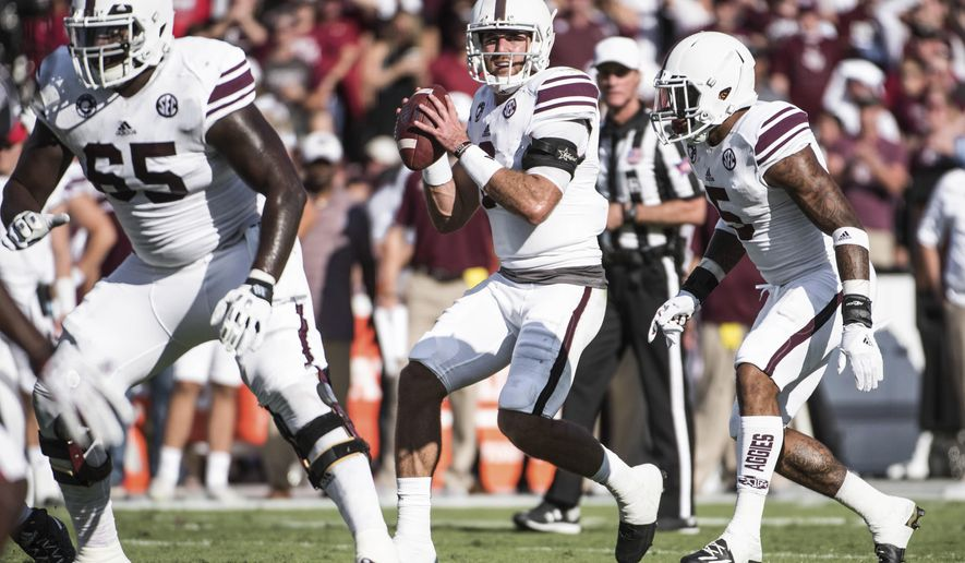 Texas A&M quarterback Trevor Knight, center, looks for a passing lane during the first half of an NCAA college football game against South Carolina, Saturday, Oct. 1, 2016, in Columbia, S.C. (AP Photo/Sean Rayford)
