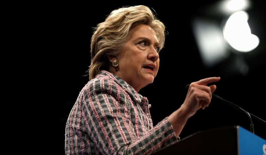 Following sharp criticism from Republicans that the TV ads were opportunistic and insensitive to the destruction and suffering expected from the Category 4 hurricane, Hillary Clinton's campaign postponed the ads just as the five-day $63,000 ad buy began to air on the Weather Channel. (Associated Press)