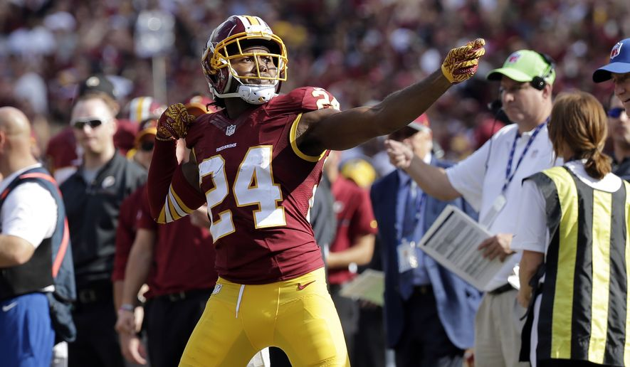 "Washington Redskins cornerback Josh Norman (24) celebrates his interception with a ""bow and arrow,"" and was penalized for the celebration during the second half of an NFL football game against the Cleveland Browns, Sunday, Oct. 2, 2016, in Landover, Md. (AP Photo/Chuck Burton)"