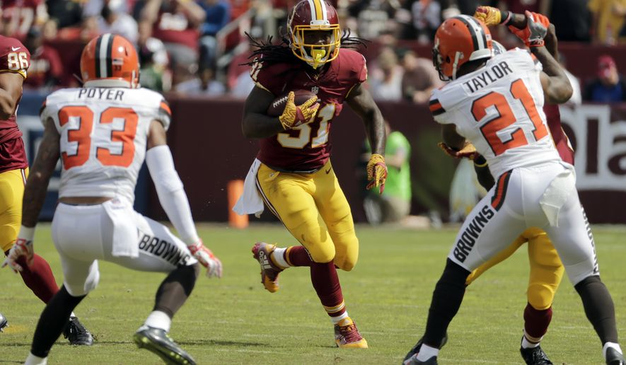 Washington Redskins running back Matt Jones (31) runs with the ball as Cleveland Browns free safety Jordan Poyer (33) waits for him, during the first half of an NFL football game Sunday, Oct. 2, 2016, in Landover, Md. (AP Photo/Chuck Burton)