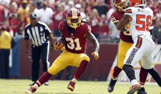 Washington Redskins running back Matt Jones (31) runs with the ball during the first half of an NFL football game against the Cleveland Browns Sunday, Oct. 2, 2016, in Landover, Md. (AP Photo/Carolyn Kaster)