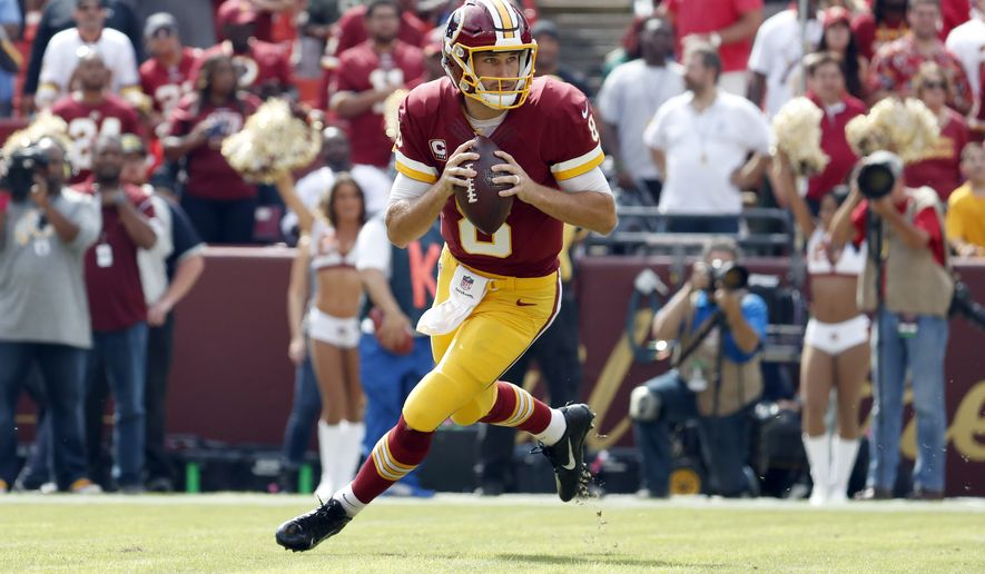 Washington Redskins quarterback Kirk Cousins (8) looks to pass during the first half of an NFL football game against the Cleveland Browns, Sunday, Oct. 2, 2016, in Landover, Md. (AP Photo/Carolyn Kaster)
