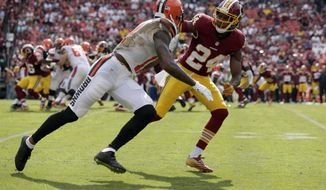 Cleveland Browns wide receiver Terrelle Pryor (11) is defended by Washington Redskins cornerback Josh Norman (24) during the second half of an NFL football game Sunday, Oct. 2, 2016, in Landover, Md. (AP Photo/Mark Tenally)