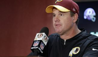 Washington Redskins head coach Jay Gruden speaks during a media availability after an NFL football game against the Cleveland Browns, Sunday, Oct. 2, 2016, in Landover, Md. The Redskins won 31-20. (AP Photo/Chuck Burton)