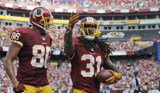 Washington Redskins tight end Jordan Reed (86) and running back Matt Jones (31) celebrate Jones' touchdown during the second half of an NFL football game against the Cleveland Browns, Sunday, Oct. 2, 2016, in Landover, Md. (AP Photo/Chuck Burton)