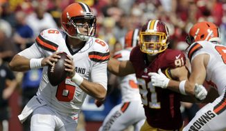 Cleveland Browns quarterback Cody Kessler (6) looks to pass under pressure from Washington Redskins outside linebacker Ryan Kerrigan (91) during the first half of an NFL football game Sunday, Oct. 2, 2016, in Landover, Md. (AP Photo/Chuck Burton)