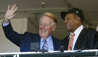 Los Angeles Dodgers announcer Vin Scully waves to fans alongside Hall of Famer baseball player Willie Mays during the fourth inning of a baseball game between the San Francisco Giants and the Los Angeles Dodgers in San Francisco, Sunday, Oct. 2, 2016. (AP Photo/Tony Avelar)