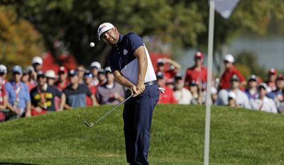 United States' Ryan Moore hits to the ninth hole during a singles match at the Ryder Cup golf tournament Sunday, Oct. 2, 2016, at Hazeltine National Golf Club in Chaska, Minn. (AP Photo/Chris Carlson)