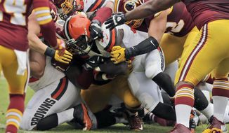 Cleveland Browns running back Isaiah Crowell, center, lunges to score a touchdown during the first half of an NFL football game against the Washington Redskins, Sunday, Oct. 2, 2016, in Landover, Md. (AP Photo/Chuck Burton)