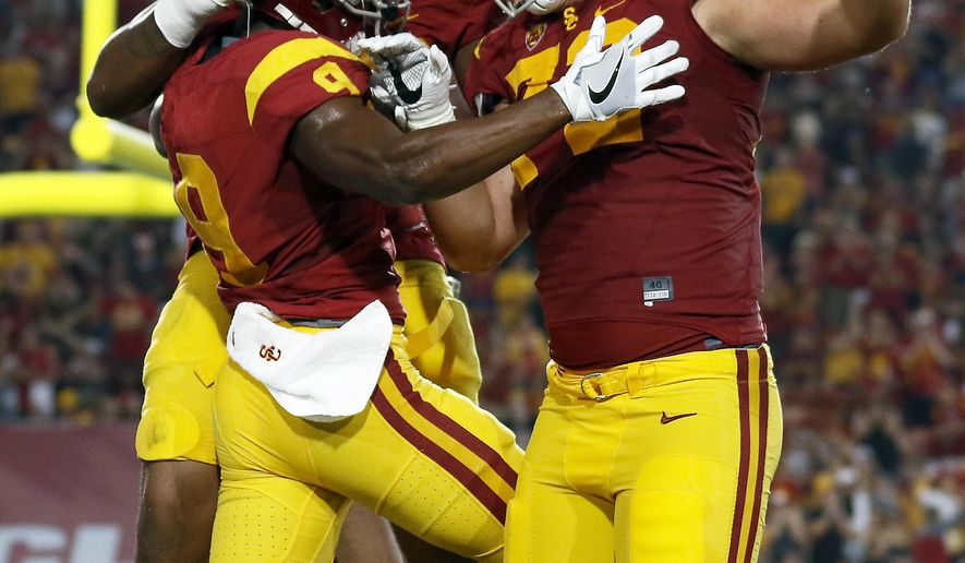 From left to right: Southern California wide receiver JuJu Smith-Schuster, offensive tackle Chuma Edoga and offensive tackle Chad Wheeler (72) celebrate after Smith-Schuster scored a touchdown during the first half of an NCAA college football game against Arizona State Saturday, Oct. 1, 2016, in Los Angeles. (AP Photo/Ryan Kang)
