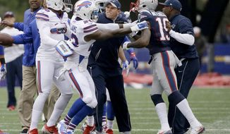 Buffalo Bills safety Aaron Williams (23) and New England Patriots wide receiver Malcolm Mitchell (19) have to be separated after they tangled during warm-up's before an NFL football game Sunday, Oct. 2, 2016, in Foxborough, Mass. (AP Photo/Elise Amendola)