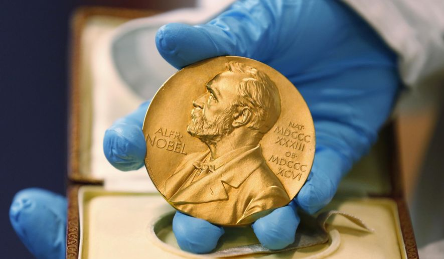 In this file photo dated Friday, April 17, 2015, a national library employee shows the gold Nobel Prize medal awarded to the late novelist Gabriel Garcia Marquez, in Bogota, Colombia.  There is no bigger international honor than the Nobel Prize, created by 19th-century Swedish industrialist Alfred Nobel, and the 2016 laureates will be named over the coming days to join the pantheon of greats who were honored in years gone by. (AP Photo/Fernando Vergara, FILE)