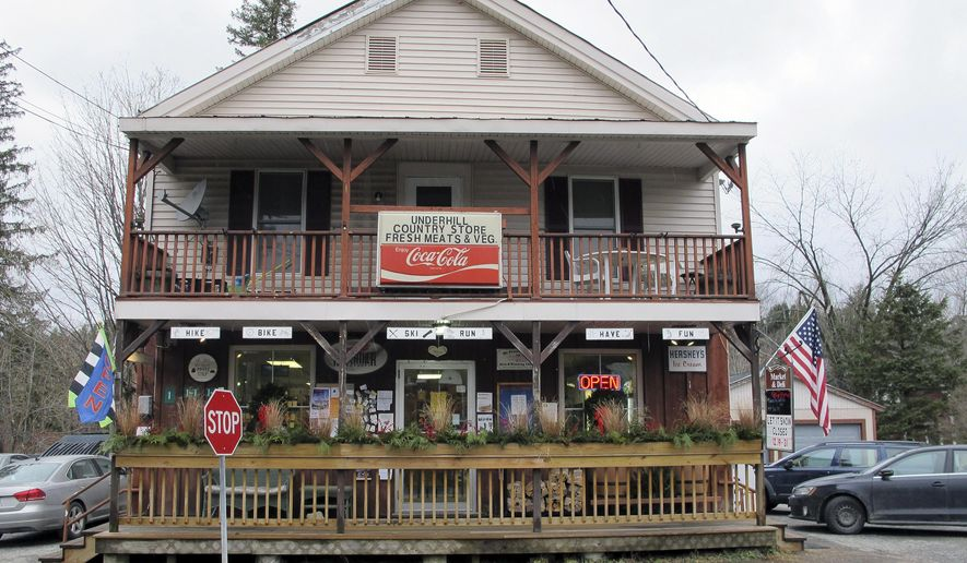 FILE - This Dec. 18, 2015, photo shows the Underhill Country Store in Underhill, Vt. Less than a year after the community came together to save the store, the board of the cooperative formed to run it voted to close it after running out of money to keep the operation going. (AP Photo/Lisa Rathke, File)
