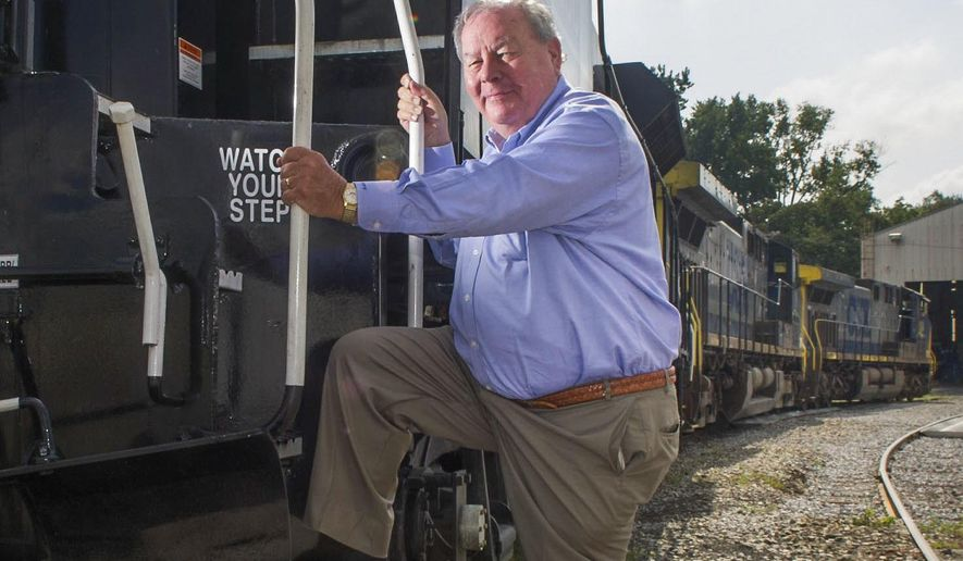 This photo taken Aug. 8, 2012, shows Gulf & Ohio Railroads Chairman Pete Claussen in Knoxville, Tenn., who has donated a restored segregation-era railroad passenger car to the National Museum of African American History and Culture in Washington D.C. (J. Miles Cary/Knoxville News Sentinel via AP)