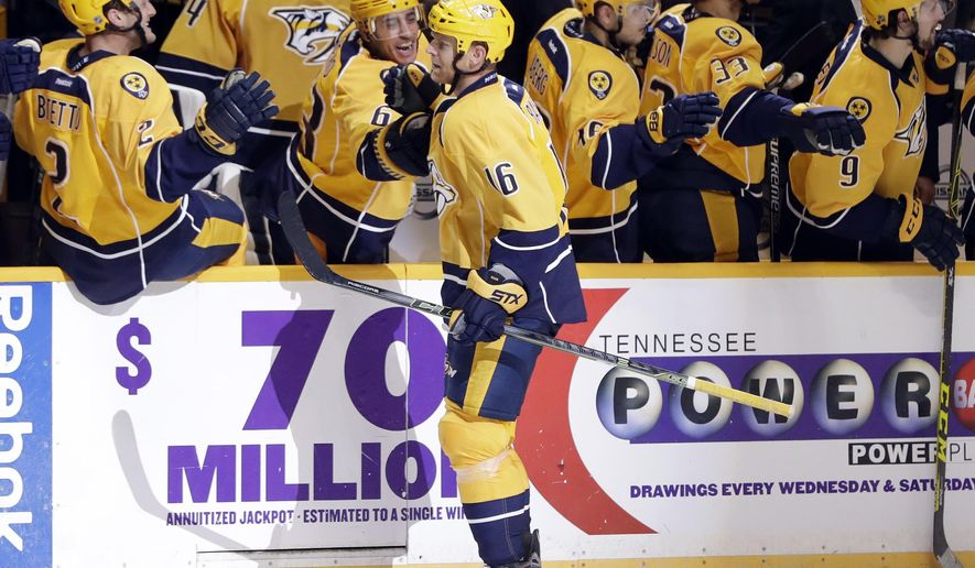 Nashville Predators center Cody Bass (16) is congratulated after scoring against the Tampa Bay Lightning during the third period of an NHL hockey preseason game Saturday, Oct. 1, 2016, in Nashville, Tenn. The goal gave the Predators a 4-3 win. (AP Photo/Mark Humphrey)
