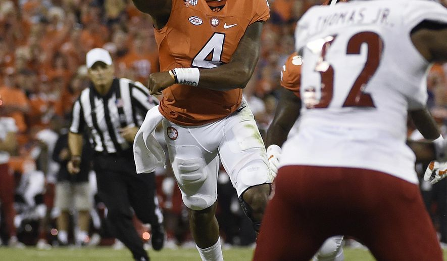 Clemson quarterback Deshaun Watson (4) throws a pass as Louisville linebacker Stacy Thomas (32) defends during the first half of an NCAA college football game Saturday, Oct. 1, 2016, in Clemson, S.C. (AP Photo/Rainier Ehrhardt)