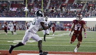 Michigan State's Vayante Copeland (13) intercepts a pass intended for Indiana's Mitchell Paige (87) during the first half of an NCAA college football game, Saturday, Oct. 1, 2016, in Bloomington, Ind. (AP Photo/Darron Cummings)