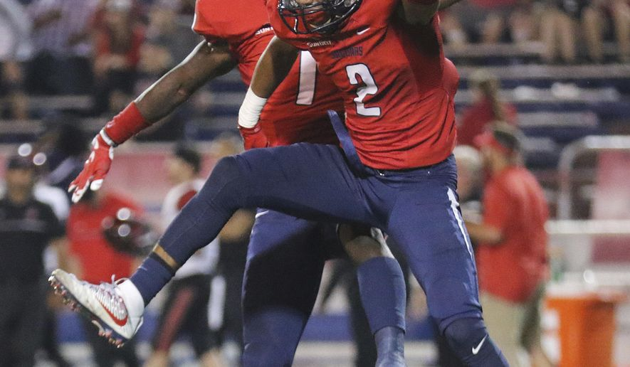 South Alabama wide receiver Tyrone Williams, right, and offensive lineman Colby Sawyer celebrate during the second half against San Diego State in an NCAA college football game, Saturday, Oct. 1, 2016, in Mobile, Ala. South Alabama defeated San Diego State 42-24 .(AP Photo/Dan Anderson)