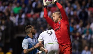 Vancouver Whitecaps goalkeeper David Ousted makes a save against the Seattle Sounders during the second half of an MLS soccer game, Sunday, Oct. 2, 2016, in Vancouver, British Columbia. (Ben Nelms/The Canadian Press via AP)