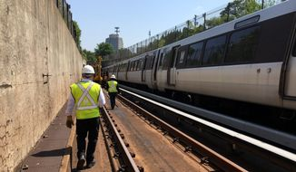 "Dubbed the ""Metrorail Safety Commission Interstate Compact,"" the legislation would authorize a group of oversight officials to devise and enforce Metro safety rules, conduct inspections, impose citations and order priority funding. (Associated Press)"