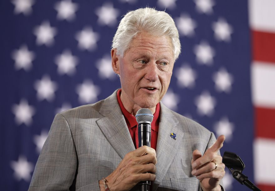 """""""You've got this crazy system where all of a sudden 25 million more people have health care and then the people are out there busting it, sometimes 60 hours a week, wind up with their premiums doubled and their coverage cut in half,"""" Bill Clinton said. """"It's the craziest thing in the world."""" (Associated Press)"""