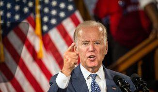 Vice President Joe Biden campaigns for Democratic presidential nominee Hillary Clinton at Church Street Station in Orlando, Fla., on Monday, Oct. 3, 2016.  (Loren Elliott/The Tampa Bay Times via AP)