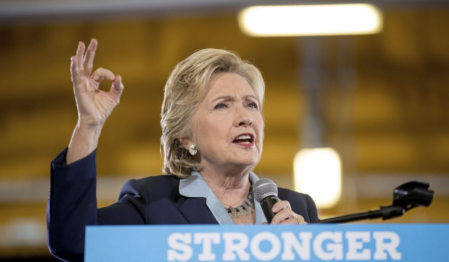 Democratic presidential candidate Hillary Clinton speaks at a rally at Goodyear Hall and Theater in Akron, Ohio, Monday, Oct. 3, 2016. (AP Photo/Andrew Harnik)
