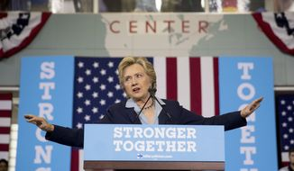 Democratic presidential candidate Hillary Clinton speaks at a rally at the Downtown Toledo Train Station in Toledo, Ohio, Monday, Oct. 3, 2016. (AP Photo/Andrew Harnik)
